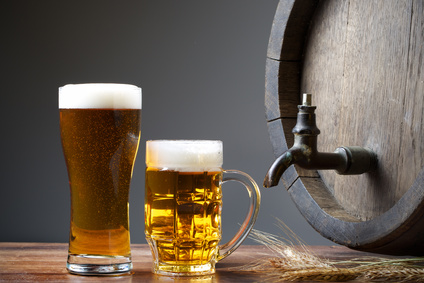 Beer with barrel on wooden table